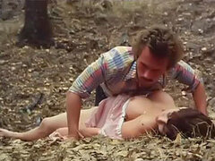 Horny dude fucks a sexy brunette babe outdoors in a vintage porn scene
