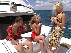 Sexy Blondes Elza Brown and Jodie Moore Fuck in Threesome on a Boat