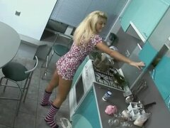 Blonde teases her boyfriend in the kitchen