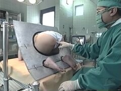 Japanese chick gets her snatch toyed at the proctologist's