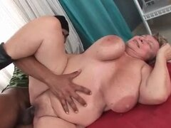 BBW granny with huge tits enjoying big black dick